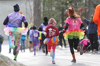 runners in clown costume